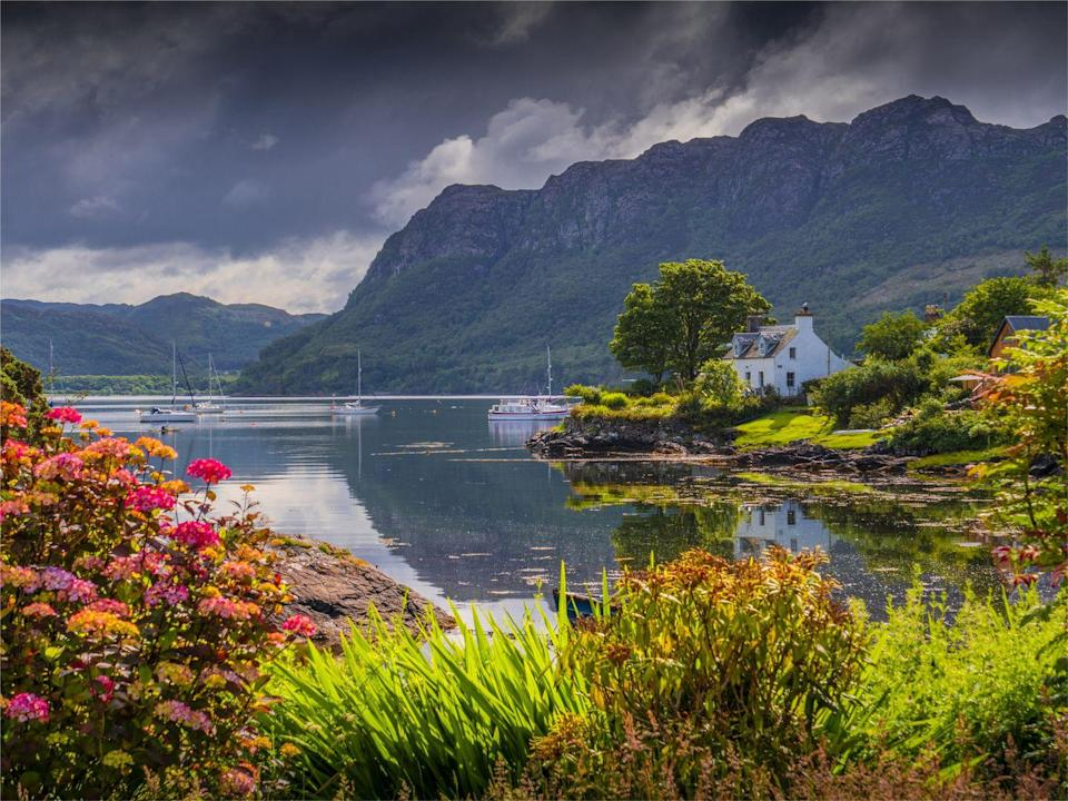 """<p>Known as the 'Jewel of the Highlands', Plockton is a lovely little waterside village surrounded by a classic Highland landscape of pine trees and snow-capped mountains. </p><p>The glassy waters of Loch Carron are often busy with yachts and small fishing boats, and a handful of great restaurants mean it's a great destination for foodies too - but it's just as much a place for simply breathing in some fresh air and re-energising body and soul.</p><p><strong>Browse Good Housekeeping's selection of amazing Scottish staycations, from <a href=""""https://www.goodhousekeepingholidays.com/tours/scotland-hebrides-islands-islay-mull-cruise"""" rel=""""nofollow noopener"""" target=""""_blank"""" data-ylk=""""slk:island hopping in the Hebrides"""" class=""""link rapid-noclick-resp"""">island hopping in the Hebrides</a> to a <a href=""""https://www.goodhousekeepingholidays.com/tours/scotland-rail-steam-tour-carol-kirkwood"""" rel=""""nofollow noopener"""" target=""""_blank"""" data-ylk=""""slk:Highland steam train adventure with Carol Kirkwood"""" class=""""link rapid-noclick-resp"""">Highland steam train adventure with Carol Kirkwood</a>.</strong></p><p><a class=""""link rapid-noclick-resp"""" href=""""https://www.goodhousekeepingholidays.com/search?locations%5Bsearch%5D=Scotland%2C+UK&locations%5Bgeo%5D=54.633238%2C-8.650007%2C60.860751%2C-0.724675"""" rel=""""nofollow noopener"""" target=""""_blank"""" data-ylk=""""slk:BROWSE NOW"""">BROWSE NOW</a></p><p> <strong>We want to help you stay inspired. Sign up for the latest travel tales and to hear about our favourite financially protected escapes and bucket list adventures.</strong></p><p><a class=""""link rapid-noclick-resp"""" href=""""https://hearst.emsecure.net/optiext/optiextension.dll?ID=Mf2Mbm2t6kFIB2qaqu7QV5QAIooPPMrcO%2BU6d2SmsL4zpSgeyQIbzx5P9sbmxMKLhPooFIrsXaC2MY"""" rel=""""nofollow noopener"""" target=""""_blank"""" data-ylk=""""slk:SIGN UP"""">SIGN UP</a></p>"""