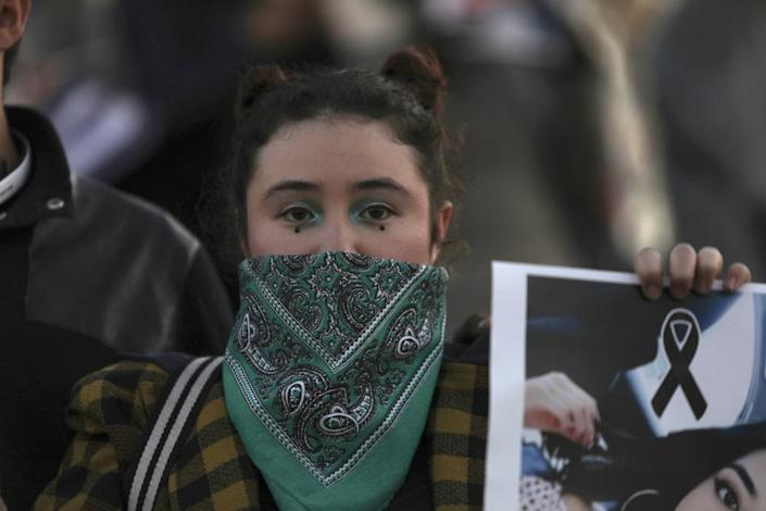 A women takes part in a demonstration against gender violence in Tijuana, Mexico, Saturday, Feb. 15, 2020. The demonstration comes after last week's vicious murder of Ingrid Escamilla by her boyfriend and controversy unleashed by the leaking of images of her body to the press.
