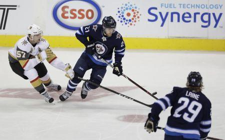 May 20, 2018; Winnipeg, Manitoba, CAN; Winnipeg Jets left wing Nikolaj Ehlers (27) chases the puck with Vegas Golden Knights left wing David Perron (57) in the second period in game five of the Western Conference Final of the 2018 Stanley Cup Playoffs at Bell MTS Centre. Mandatory Credit: James Carey Lauder-USA TODAY Sports