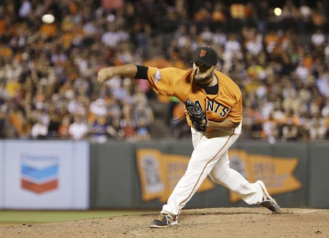 San Francisco Giants starting pitcher Yusmeiro Petit throws against the Arizona Diamondbacks in the sixth inning of their baseball game Friday, Sept. 6, 2013, in San Francisco. (AP Photo/Eric Risberg)