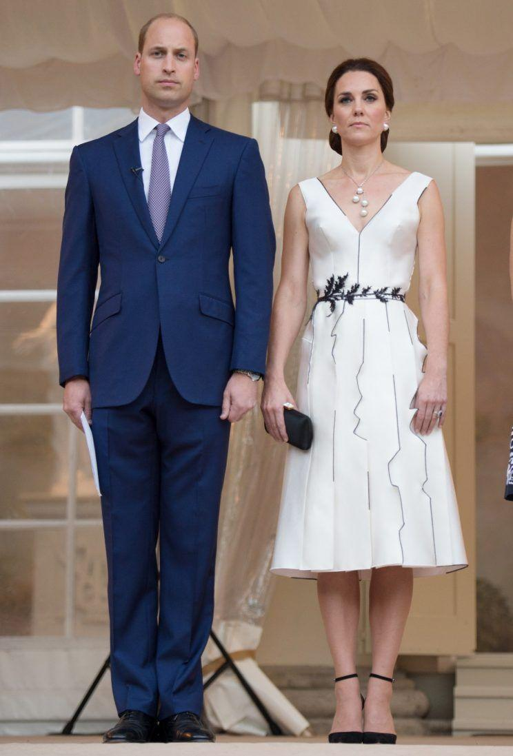 <p>Kate's cocktail dress on the first day of her visit to Poland was the brainchild of Polish designer Gosia Baczyńska. The architectural midi dress was teamed with classic black heels by Gianvito Rossi and Balenciaga pearl earrings.<br><i>[Photo: Getty]</i> </p>