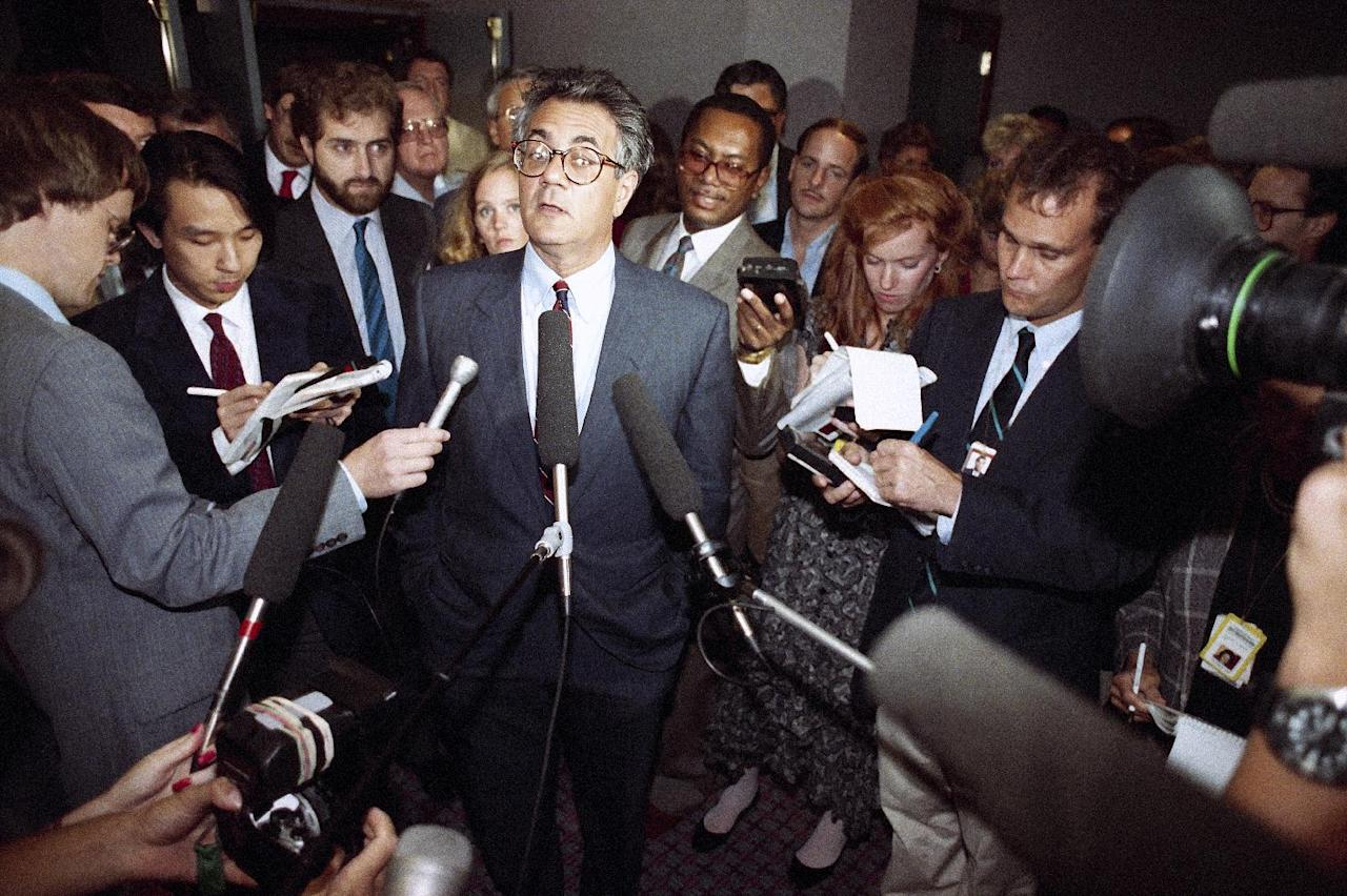 FILE - In this Sept. 13, 1989 file photo, Rep. Barney Frank, D-Mass., center, faces reporters at a Washington Hotel. Frank's office says he won't seek re-election in 2012. (AP Photo/Charles Tasnadi, File)