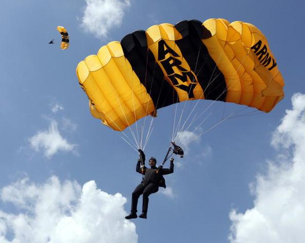The U.S. Army's Golden Knights float into Wallace Wade Stadium in Durham, North Carolina, on Saturday, September 25, 2010. Army went on to defeat host Duke, 35-21. (Chuck Liddy/Raleigh News & Observer/MCT via Getty Images)