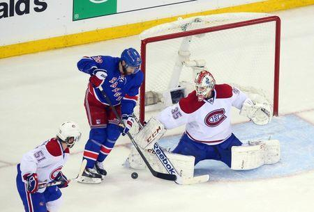 May 22, 2014; New York, NY, USA; Montreal Canadiens goalie Dustin Tokarski (35) makes a save against New York Rangers center Dominic Moore (28) during the third period in game three of the Eastern Conference Final of the 2014 Stanley Cup Playoffs at Madison Square Garden. Ed Mulholland-USA TODAY Sports