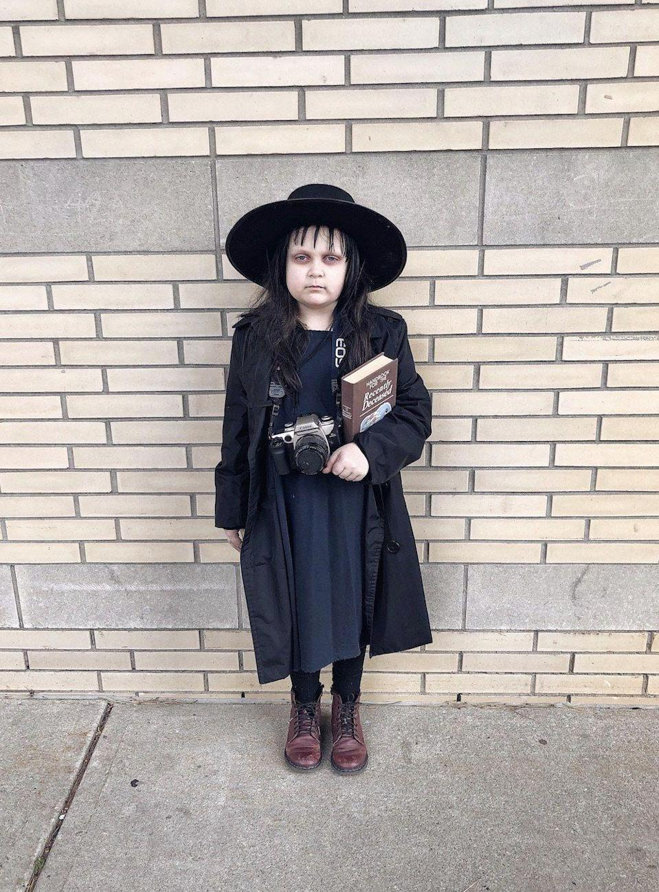 """<p>Channel your inner Winona Ryder this Halloween with this DIY Lydia Deetz costume. Don't forget your <em>Handbook for the Recently Deceased</em>! </p><p><strong>See more at <a href=""""http://livelovesara.com/2019/10/lydia-deetz-hallloween-costume/"""" rel=""""nofollow noopener"""" target=""""_blank"""" data-ylk=""""slk:Live Love Sara"""" class=""""link rapid-noclick-resp"""">Live Love Sara</a>. </strong></p><p><a class=""""link rapid-noclick-resp"""" href=""""https://go.redirectingat.com?id=74968X1596630&url=https%3A%2F%2Fwww.walmart.com%2Fip%2FS-noilite-8-Bangs-Clip-in-Hair-Extensions-Front-Neat-Bang-Fringe-One-Piece-Striaght-Hairpiece-Accessories-Side-bangs-Ash-blonde-8-30g%2F577778847&sref=https%3A%2F%2Fwww.thepioneerwoman.com%2Fholidays-celebrations%2Fg32645069%2F80s-halloween-costumes%2F"""" rel=""""nofollow noopener"""" target=""""_blank"""" data-ylk=""""slk:SHOP CLIP-ON BANGS"""">SHOP CLIP-ON BANGS</a></p>"""