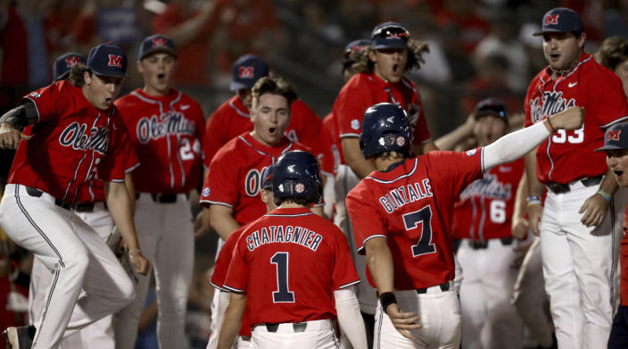 The Mississippi bench comes out to celebrate a two-run home run by Peyton Chatagnier (1) against Arizona during the second inning of an NCAA college baseball tournament super regional game Saturday, June 12, 2021, in Tucson, Ariz. (Kelly Presnell/Arizona Daily Star via AP)