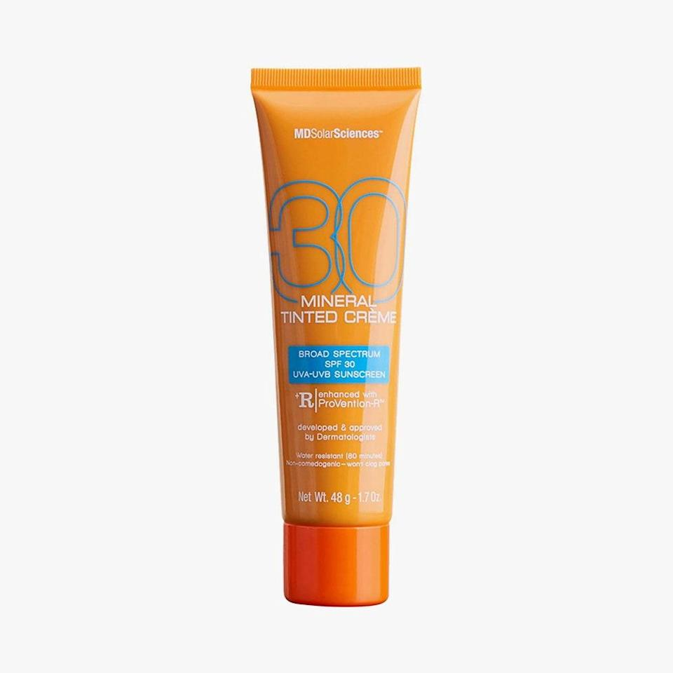 """For those partial to a tint for light coverage, this expert-approved, sweat-resistant mineral cream can function as a primer. It goes on satiny smooth and is packed with antioxidants, such as free-radical fighting vitamin C and healing vitamin E, to help mend environmental damage. $32, MDSOLARSCIENCES. <a href=""""https://shop-links.co/1707054285618749369"""" rel=""""nofollow noopener"""" target=""""_blank"""" data-ylk=""""slk:Get it now!"""" class=""""link rapid-noclick-resp"""">Get it now!</a>"""