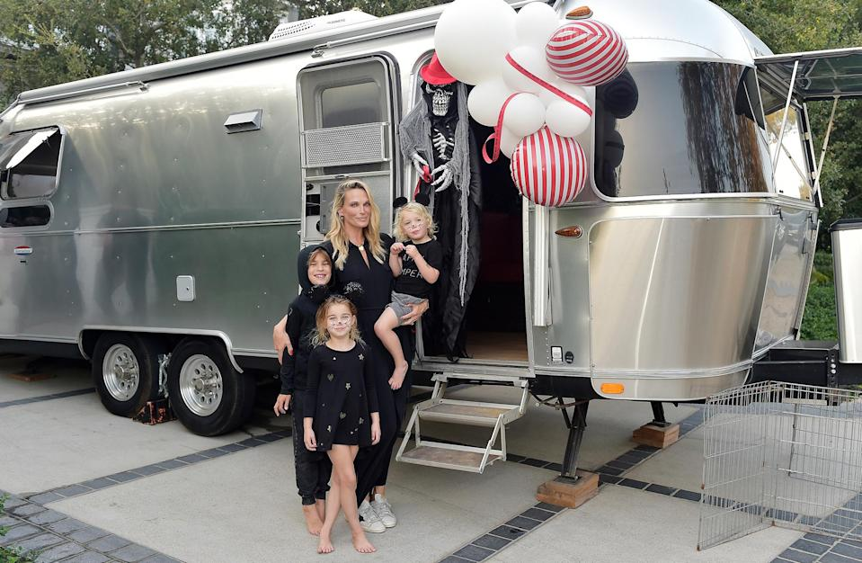"<p>Molly Sims, in partnership with <a href=""https://www.outdoorsy.com/"" rel=""nofollow noopener"" target=""_blank"" data-ylk=""slk:Outdoorsy"" class=""link rapid-noclick-resp"">Outdoorsy</a>, hosts a fun Halloween ""Carnevil"" campsite in her backyard.</p>"