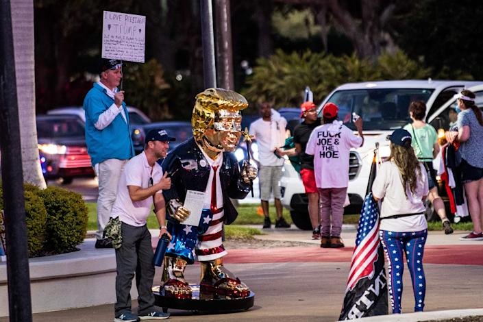 <p>Golden statue of former US president Donald Trump at CPAC</p> (AFP via Getty)