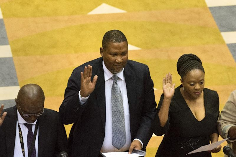 Oath of office: Mandla Mandela, centre, the grandson of Nelson Mandela, was sworn in alongside other newly-elected MPs (AFP Photo/RODGER BOSCH)