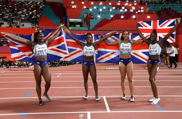 Asha Philip, Dina Asher-Smith, Ashleigh Nelson and Daryll Neita celebrate their silver medal (Martin Rickett/PA).