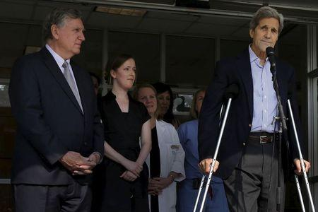 United States Secretary of State John Kerry, with Dr. Dennis Burke at his side, speaks to reporters outside Massachusetts General Hospital in Boston