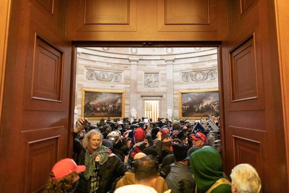 Pro-Trump insurrectionists storm the Capitol after President Donald Trump told them to march on the building to stop Congress from certifying President-elect Joe Biden's win. (Photo: Photo by Mostafa Bassim/Anadolu Agency via Getty Images)