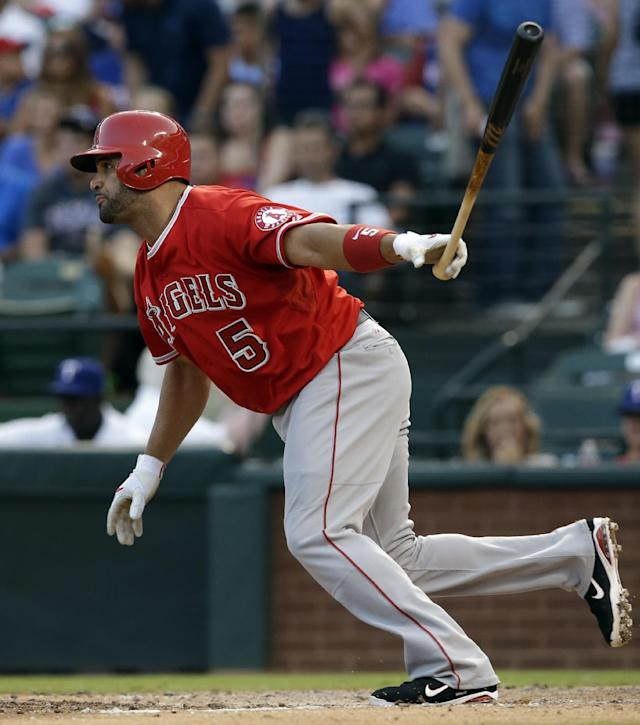 Los Angeles Angels' Albert Pujols follows through on a single to center off a pitch from Texas Rangers' Nick Tepesch in the fourth inning of a baseball game, Friday, July 11, 2014, in Arlington, Texas. (AP Photo/Tony Gutierrez)