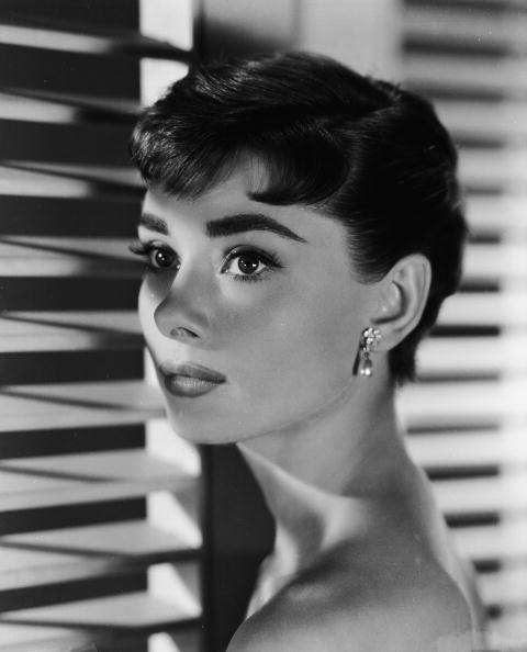 <p>Audrey Hepburn was always one for setting hair trends, but none were more iconic than her pixie for her 1954 film, <em>Sabrina. </em>Her micro-bangs gave it a bold, modern vibe — and the style caught on like wildfire. </p>