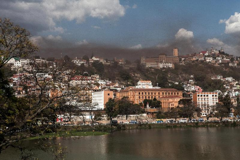 A swarm of locusts flies over the center of Mdagascar capitol Antananarivo on August 28, 2014