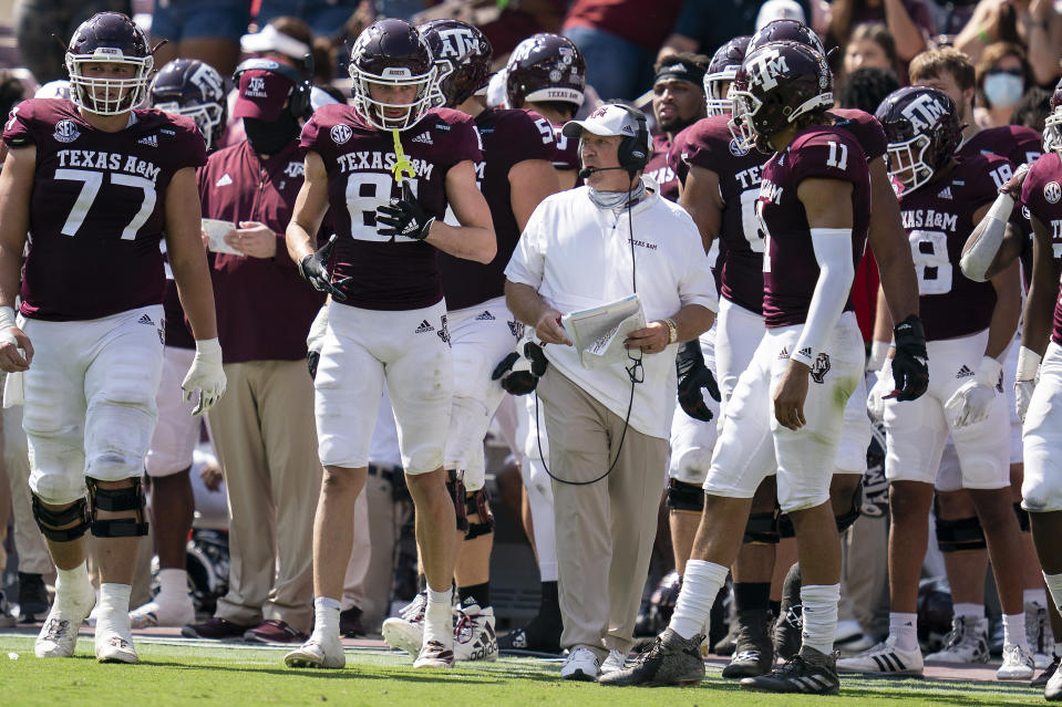 Texas A&M head coach Jimbo Fisher talks with wide receiver Caleb Chapman (81) before a snap against Florida during the first half of an NCAA college football game, Saturday, Oct. 10, 2020. in College Station, Texas. (AP Photo/Sam Craft)