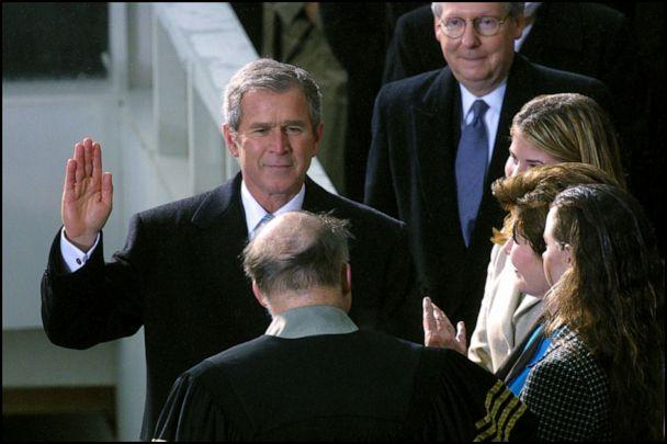 PHOTO: George W. Bush, flanked by his wife Laura and daughters Jenna and Barbra, is sworn in as President during a ceremony at the Capitol building in Washington, DC, Jan. 20, 2001. (Pool Bassignac/Gamma-Rapho via Getty Images, FILE)