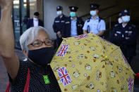 Pro-democracy activist Alexandra Wong holding yellow umbrella with British flags protests outside the Chinese central government's liaison office, in Hong Kong, Monday, Dec. 28, 2020, to demand the release of the 12 Hong Kong activists detained at sea by Chinese authorities. (AP Photo/Kin Cheung)