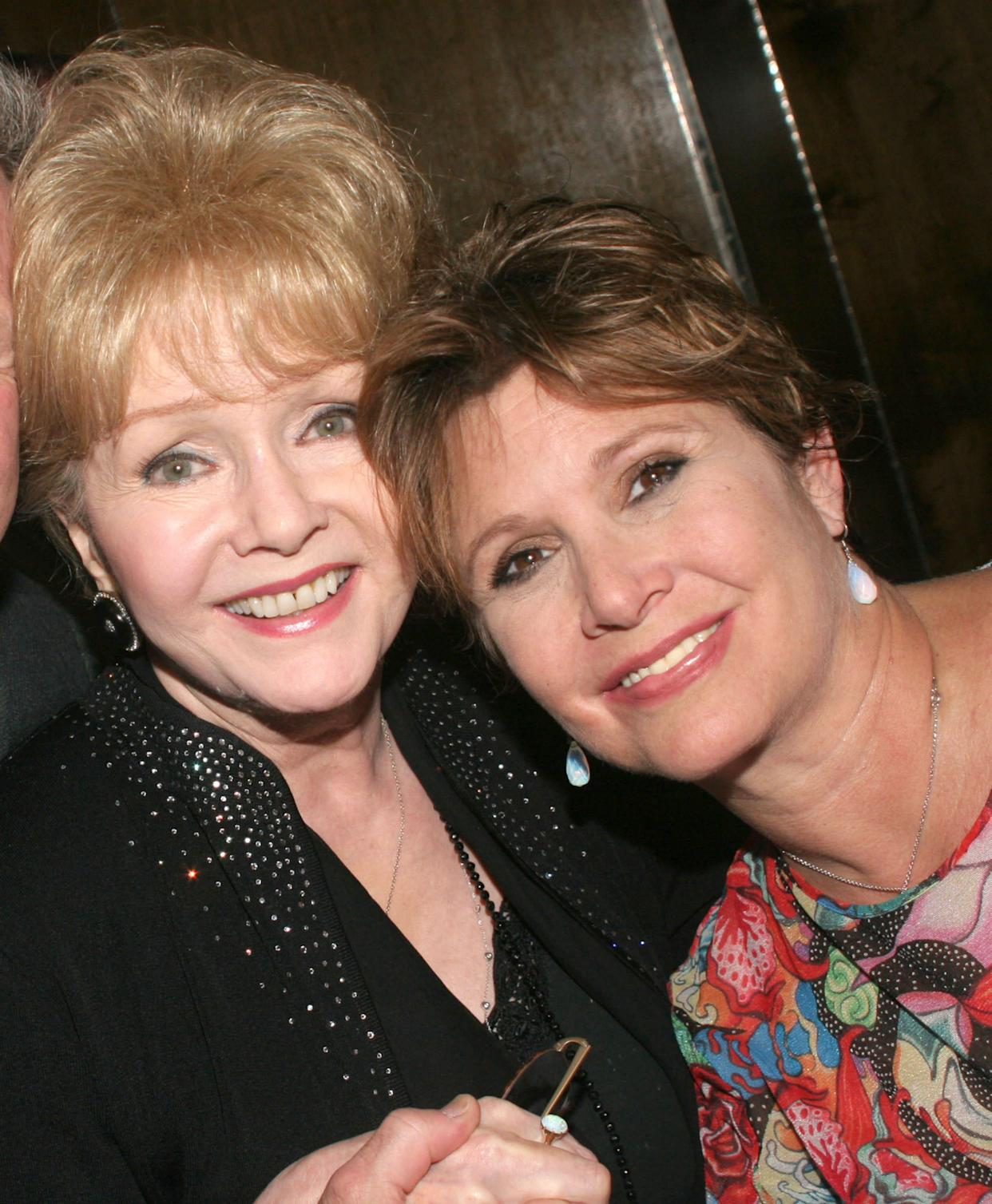 """Debbie Reynolds and Carrie Fisher at the """"Irene"""" original Broadway cast reunion in 2005."""