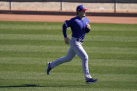 Texas Rangers pitcher Kohei Arihara, from Japan, runs during spring training baseball practice Wednesday, Feb. 24, 2021, in Surprise, Ariz. (AP Photo/Charlie Riedel)