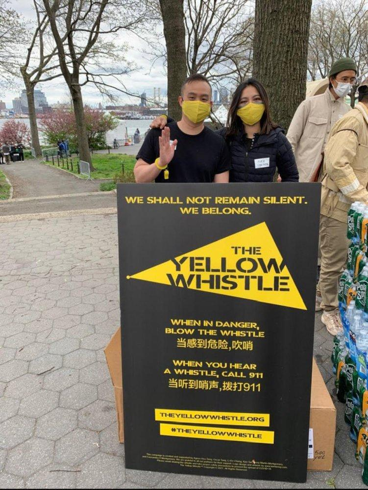 Activists help publicise and distribute yellow whistles for safety. Photo: Handout