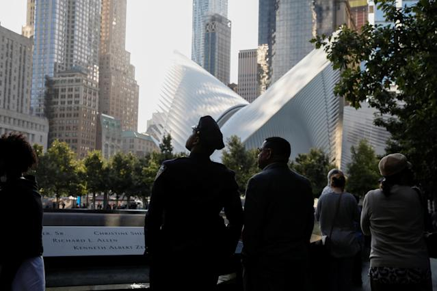 <p>People pause at the edge of the South reflecting pool at the National September 11 Memorial and Museum during ceremonies marking the 16th anniversary of the Sept. 11, 2001, attacks in New York, Sept. 11, 2017. (Photo: Brendan McDermid/Reuters) </p>