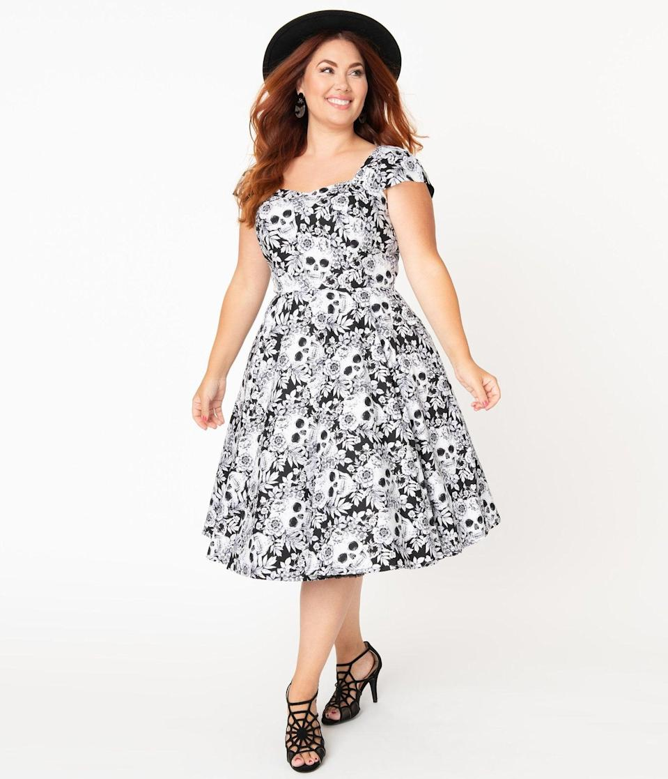 <p>The <span>Plus Size Black and White Skulls and Roses Print Aida Swing Dress</span> ($88) is sneakily spooky. </p>