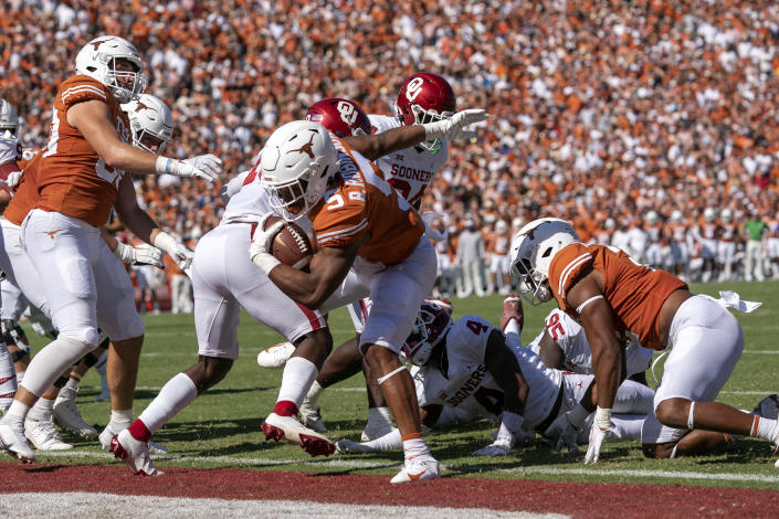 Texas running back Bijan Robinson (5) steps into the end zone against Oklahoma during the first half of an NCAA college football game at the Cotton Bowl, Saturday, Oct. 9, 2021, in Dallas. (AP Photo/Jeffrey McWhorter)