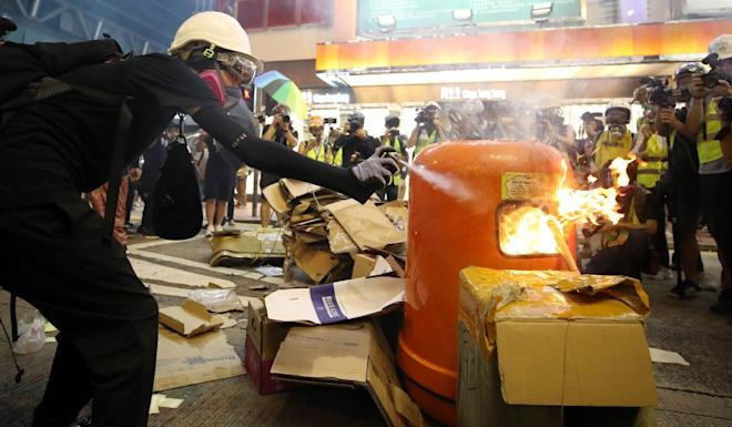 Protesters set up a fire pit on the street in Mong Kok. Photo: Winson Wong