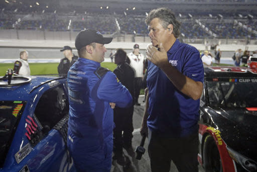 Reed Sorenson, left, talks with Michael Waltrip, a former driver and now TV commentator, on pit road before the first of two Daytona 500 qualifying auto races at Daytona International Speedway, Thursday, Feb. 13, 2020, in Daytona Beach, Fla. (AP Photo/John Raoux)