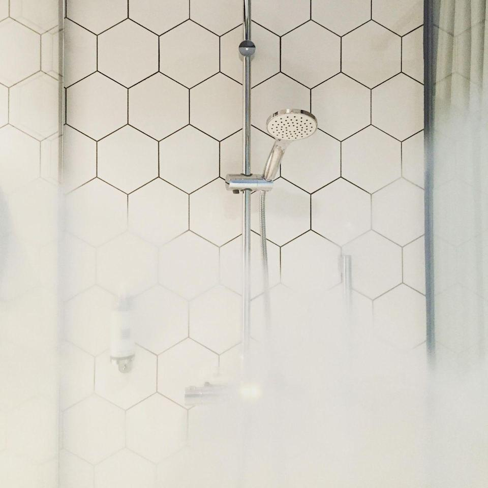 """<p>The easiest way to rid your shower tiles of grout is regular upkeep, which is why our <a href=""""http://www.goodhousekeeping.com/home/cleaning/tips/a21016/remove-grout-stain-jul04/"""" rel=""""nofollow noopener"""" target=""""_blank"""" data-ylk=""""slk:cleaning expert Heloise"""" class=""""link rapid-noclick-resp"""">cleaning expert Heloise</a> says you should run a squeegee over tile after every use. By drying the walls, you'll prevent mildew stains.</p>"""