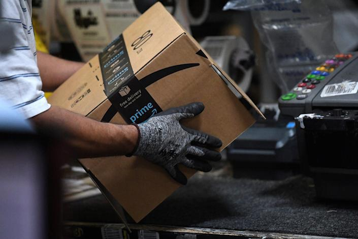 "A worker assembles a box for delivery at the Amazon fulfillment center in Baltimore, Maryland, US, April 30, 2019. <p class=""copyright"">REUTERS/Clodagh Kilcoyne/File Photo</p>"