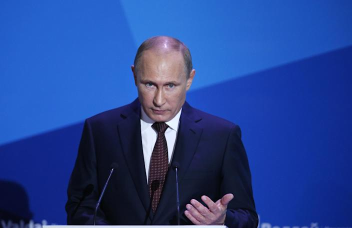 Russian President Vladimir Putin gestures as he speaks during the final plenary meeting of the Valdai International Discussion Club in the Novgorod Region, on the banks of Lake Valdai, Russia, Thursday, Sept. 19, 2013. (AP Photo/Alexander Zemlianichenko, pool)