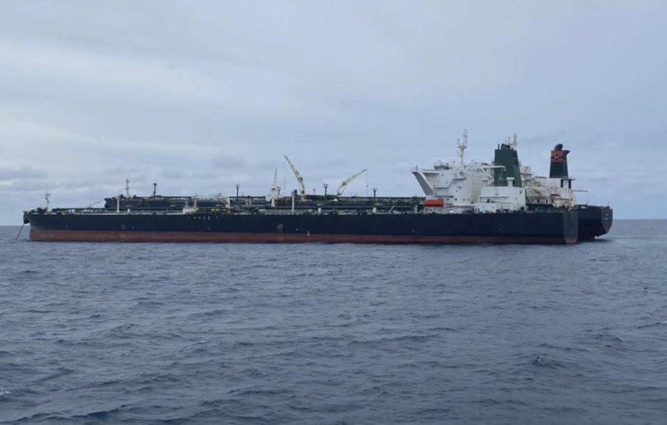 In this photo released by Indonesian Maritime Security Agency (BAKAMLA), Iranian-flagged MT Horse and Panamanian-flagged MT Frea, rear, tankers are seen anchored together in Pontianak waters off Borneo island, Indonesia, Sunday, Jan. 24, 2021. Indonesian authorities said that they seized the two vessels suspected of carrying out the illegal transfer of oil in their country's waters. (Indonesian Maritime Security Agency via AP)