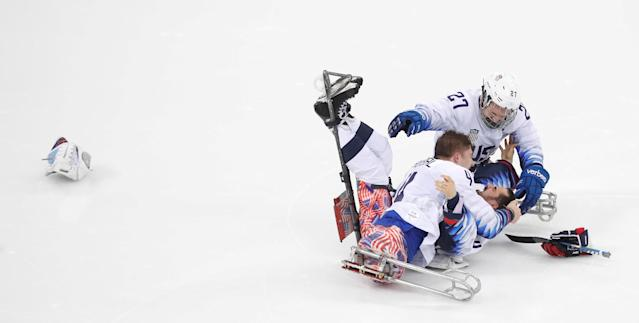 Ice Hockey - Pyeongchang 2018 Winter Paralympics - Gold Medal Game - Canada v U.S. - Gangneung Hockey Centre, Gangneung, South Korea - March 18, 2018 - Brody Roybal of the U.S. and his teammates Josh Pauls and Joshua Misiewicz celebrate winning the gold medal. REUTERS/Carl Recine TPX IMAGES OF THE DAY