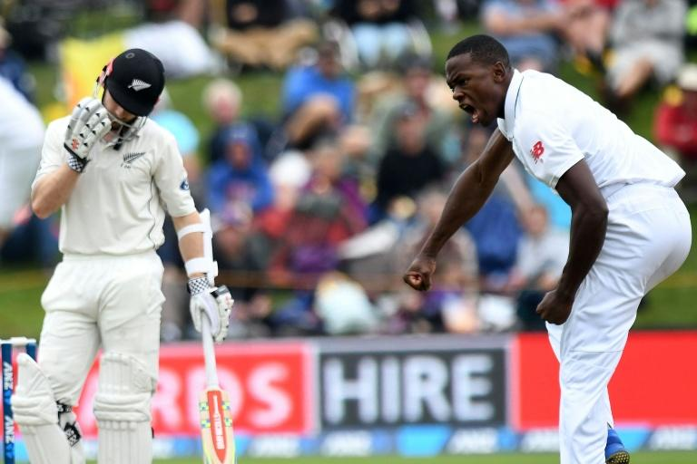 "South Africa""s Kagiso Rabada (R) celebrates taking New Zealand captain Kane Williamson's wicket for two"