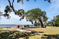"""<p>History buffs and beach lovers alike will love <a href=""""https://go.redirectingat.com?id=74968X1596630&url=https%3A%2F%2Fwww.tripadvisor.com%2FTourism-g35241-Saint_Simons_Island_Golden_Isles_of_Georgia_Georgia-Vacations.html&sref=https%3A%2F%2Fwww.thepioneerwoman.com%2Fjust-for-fun%2Fg34836106%2Fsmall-american-town-destinations%2F"""" rel=""""nofollow noopener"""" target=""""_blank"""" data-ylk=""""slk:this small island town"""" class=""""link rapid-noclick-resp"""">this small island town</a> off the Georgia coast. There, you can golf, fish, and visit plenty of historical monuments, and you can't miss climbing to the top of the St. Simons lighthouse to see the view of the entire island. </p>"""