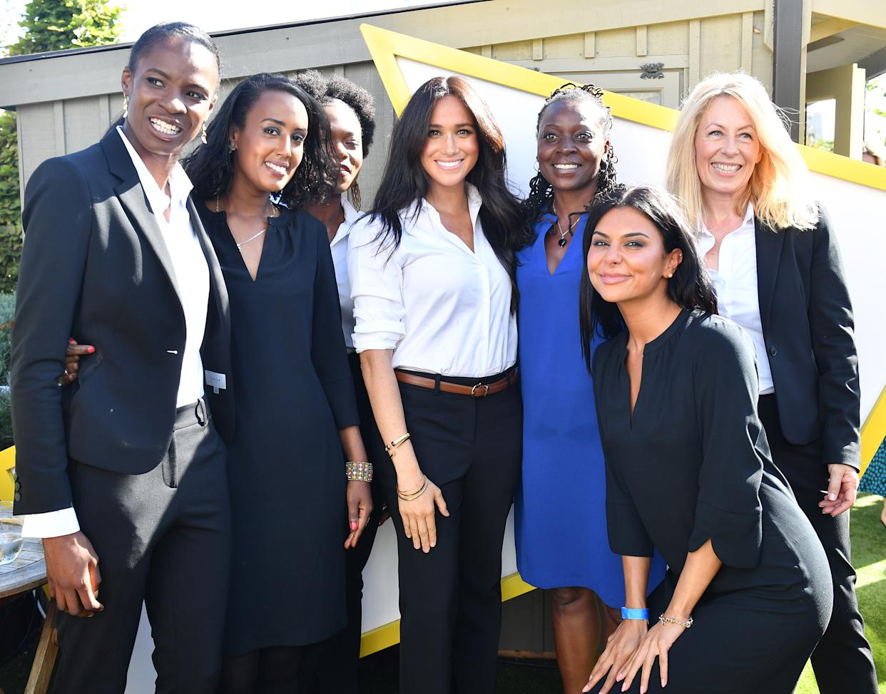 LONDON, ENGLAND - SEPTEMBER 12: Meghan, Duchess of Sussex poses for a photograph with women dressed in clothes from the Smart Works capsule collection during the collection's launch on September 12, 2019 in London, England. Created in September 2013 Smart Works exists to help unemployed women regain the confidence they need to succeed at job interviews and return to employment. (Photo by Mark Large - WPA Pool/Getty Images)