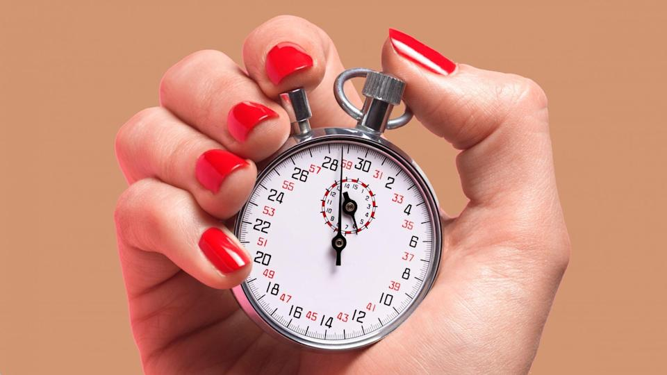 Woman holding a clock timer
