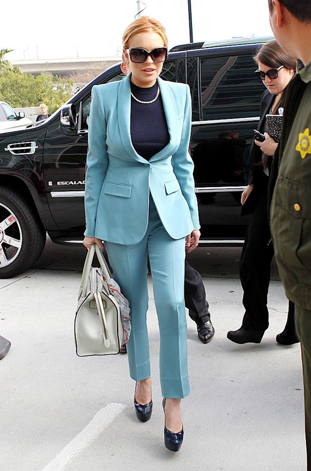 """In an attempt to appear classy and cleaned up, Lindsay Lohan donned a Tiffany-blue Givenchy suit and platform pumps for <a target=""""_blank"""" href=""""http://omg.yahoo.com/news/lindsay-lohan-appears-final-probation-hearing-174000376.html"""">her latest court hearing</a>. While we're glad to see the 25-year-old former teen queen in something sophisticated, we can't help but think she looks three times her age in this matronly getup. Thoughts?(3/29/2012)"""