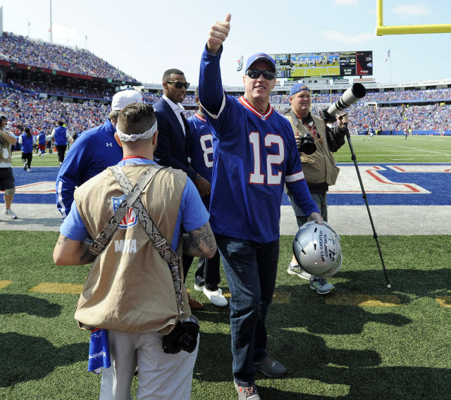 Former Buffalo Bills quarterback and Hall of Famer Jim Kelly acknowledges the crowd during a Bills game this month. (AP)