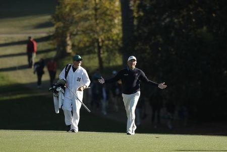 Fred Couples of the U.S. walks up the 18th fairway in second round play during the 2017 Masters golf tournament at Augusta National Golf Club in Augusta, Georgia, U.S., April 7, 2017. REUTERS/Brian Snyder