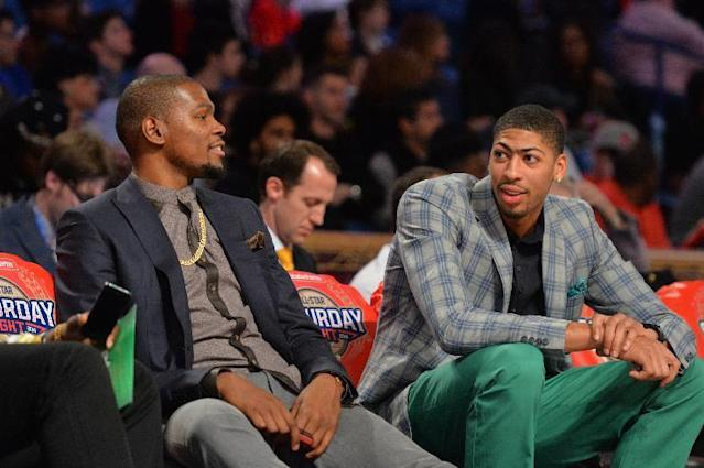 NEW ORLEANS, LA - FEBRUARY 15: Kevin Durant #35 of the Oklahoma City Thunder looks on with Anthony Davis #23 of the New Orleans Pelicans during the Sprite Slam Dunk Contest on State Farm All-Star Saturday Night as part of the 2014 All-Star Weekend at Smoothie King Center on February 15, 2014 in New Orleans, Louisiana. (Photo by Jesse D. Garrabrant/NBAE via Getty Images)