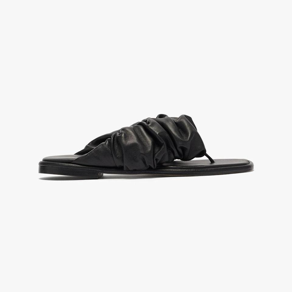 """$415, MATCHESFASHION.COM. <a href=""""https://www.matchesfashion.com/us/products/Hereu-Nuvola-ruched-strap-leather-flip-flops-1408639"""" rel=""""nofollow noopener"""" target=""""_blank"""" data-ylk=""""slk:Get it now!"""" class=""""link rapid-noclick-resp"""">Get it now!</a>"""