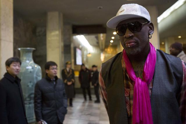 "Former NBA basketball star Dennis Rodman arrives at a hotel in Pyongyang, North Korea Monday, Jan. 6, 2014. Rodman arrived in the North Korean capital with a squad of former basketball stars in what he calls ""basketball diplomacy,"" although U.S. officials have criticized his efforts. (AP Photo/David Guttenfelder)"