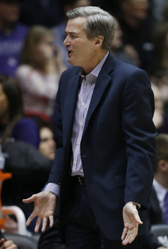 Northwestern head coach Bill Carmody talks to his team during the first half of an NCAA college basketball game against Michigan in Evanston, Ill., Thursday, Jan. 3, 2013. (AP Photo/Nam Y. Huh)