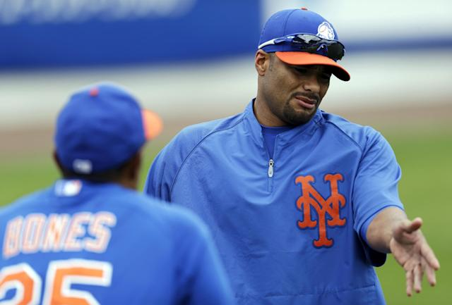 FILE - In this March 1, 2013, photo, New York Mets pitcher Johan Santana, right, talks to bullpen coach Ricky Bones before the Mets' spring training baseball game against the Detroit Tigers in Port St. Lucie, Fla. The Mets have declined a $25 million option on the injured pitcher on Friday, Nov. 1, 2013, and will pay the left-hander a $5.5 million buyout. Santana will be 35 next season and becomes a free agent. (AP Photo/Julio Cortez, File)