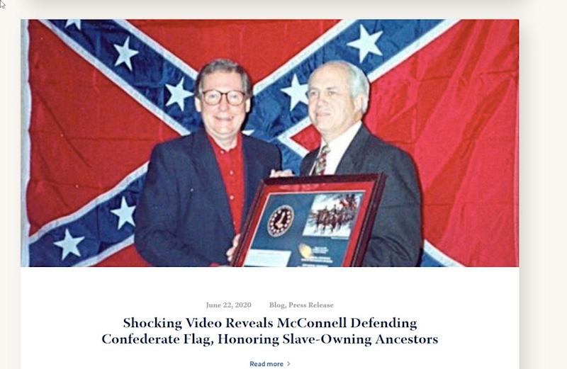 A screen capture from a Kentucky Democratic Party blog shows a picture of Senate Majority Leader in front of a Confederate battle flag. The picture, taken decades ago, is often shared on social media by McConnell critics.