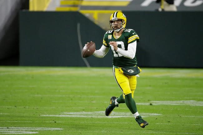 Old man quarterbacks Brady and Rodgers face off Sunday